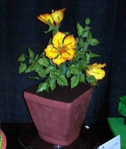 Cake shaped like a flower pot, topped with gumpaste flowers